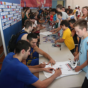 Players signing autographs for their fans during the 2nd Crete International Basketball Tournament