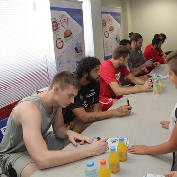 Players signing autographs for their fans during the 3rd Crete International Basketball Tournament