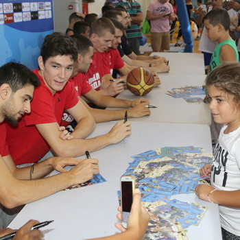 Players signing autographs for their fans during the 1st Crete International Basketball Tournament