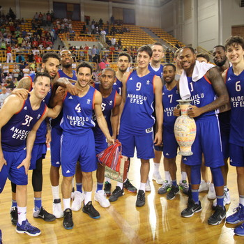 The team of Anadolu Efes celebrates with the trophy of the 1st Crete International Basketball Tournament.